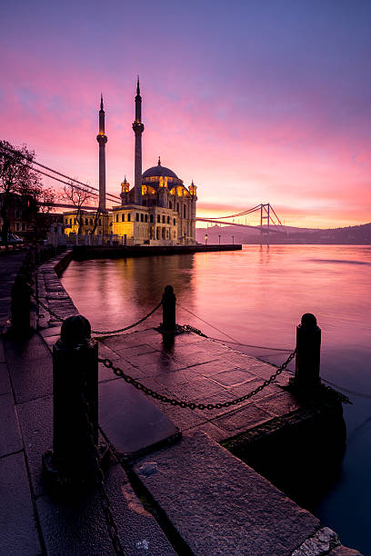 amazing sunrise at ortakoy mosque, istanbul - eminonu district stockfoto's en -beelden