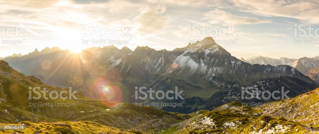 Amazing sunrise in the mountains. Nice lens flares and sunbeams stock photo