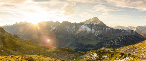 Amazing sunrise in the mountains. Nice lens flares and sunbeams Great sunrise in the mountains.Backlight with nice colorful lens flares and sunbeams. Alps, Bavaria, Tirol, Austria. bavarian alps stock pictures, royalty-free photos & images