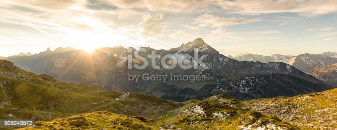 istock Amazing sunrise in the mountains. Nice lens flares and sunbeams 925243572