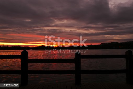 istock Amazing sunrise or sunset over a lake. 1292614003