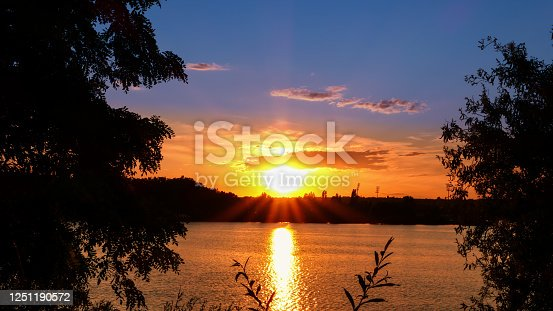 istock Amazing sunrise over a lake. 1251190572