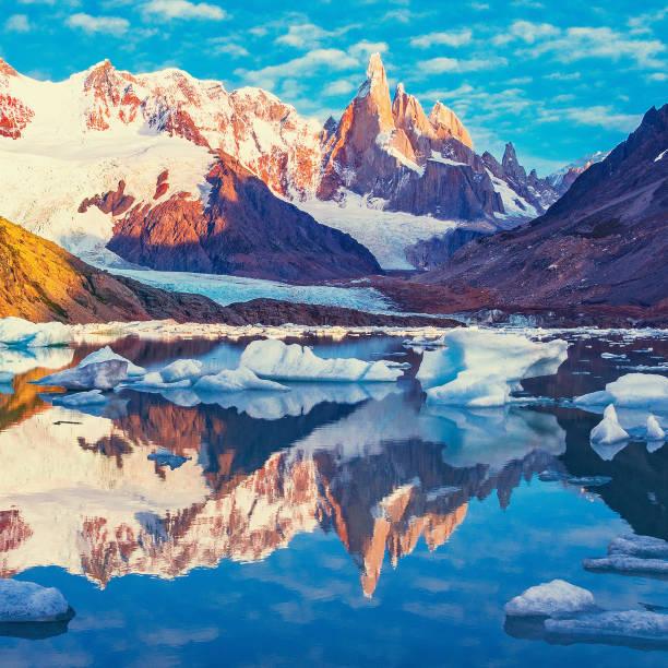 amazing sunrise view of cerro torre mountain by the lake. los glaciares national park. argentina - moraine стоковые фото и изображения