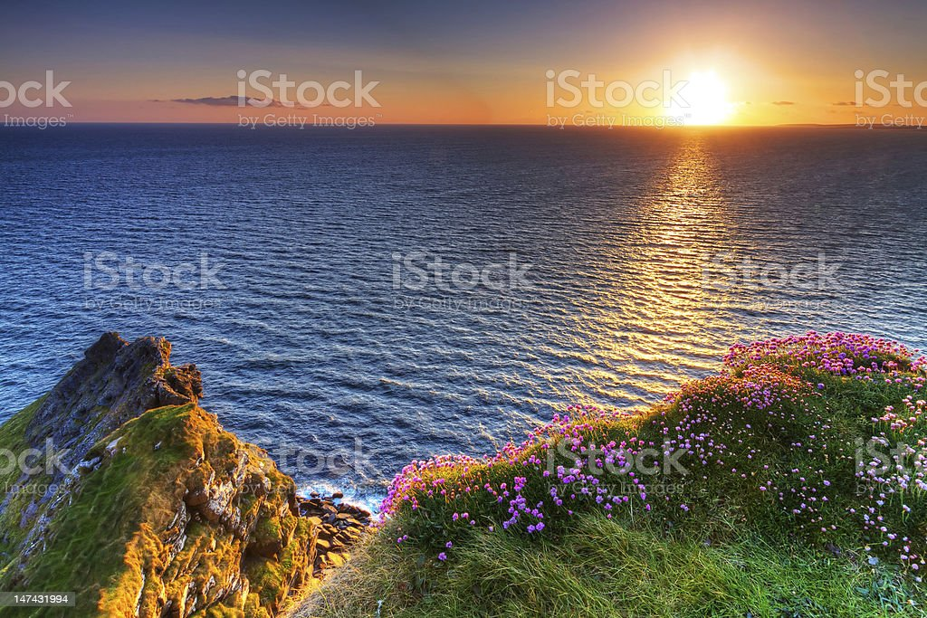 Amazing sunset at Cliffs of Moher stock photo
