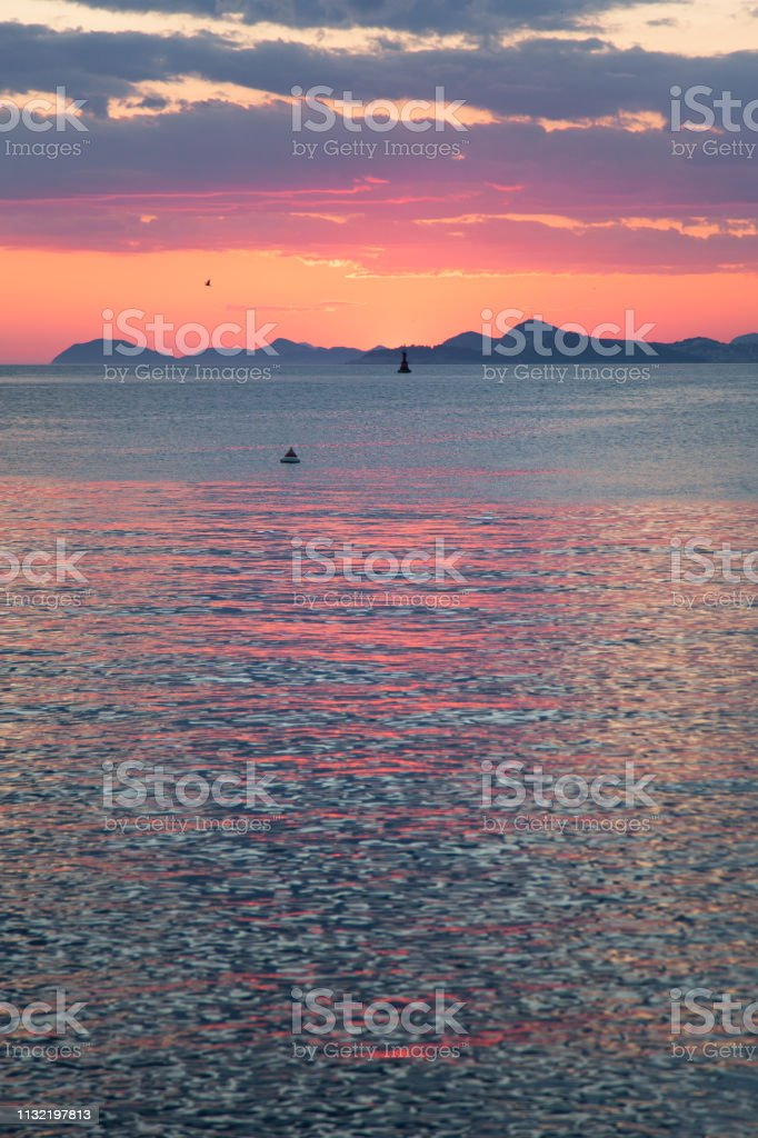 Amazing Sunset Landscape With Sea Clear Blue Water Mountains