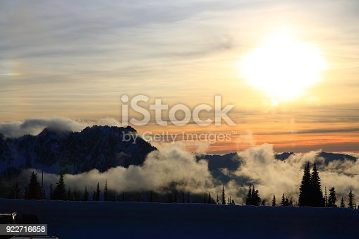 Amazing sunset over mountains with trees covered by fog, WA