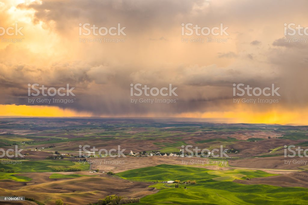 Amazing sunset sky over the green hills. Plowed fields, an incredible drawing of the earth. stock photo