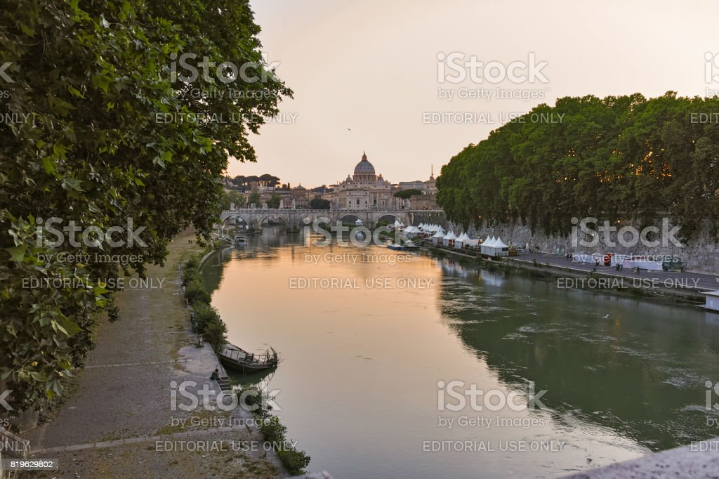 Amazing Sunset view of Tiber River and St. Peter's Basilica in Rome, Italy stock photo