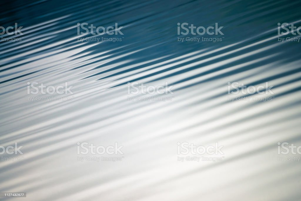 Amazing textured background of calm blue clean water surface....