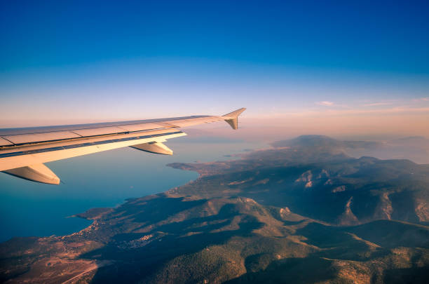 Amazing view from the plane window at the sky the aegean sea and the island of Lesvos. stock photo