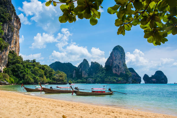 Amazing view of beautiful Ao Nang Beach with longtale boats. Location:  Krabi Province, Thailand, Andaman Sea. Artistic picture. Beauty world. stock photo