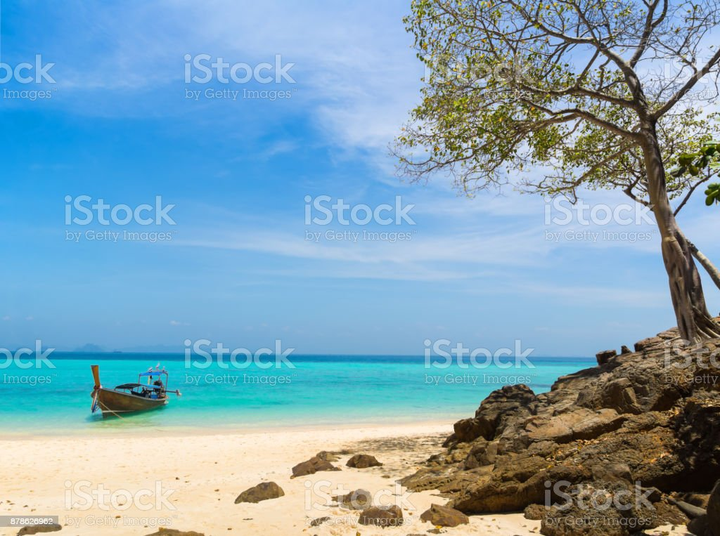 Amazing view of beautiful beach on the island with longtale boat. Location: Krabi Province, Thailand, Andaman Sea. Artistic picture. Beauty world. stock photo