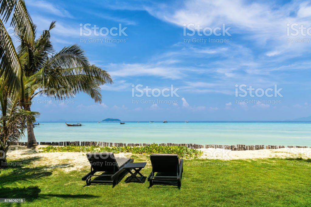 Amazing view of beautiful beach with palm trees, chaises and transparent turquoise water. A great place to relax. Location: Ko Phi Phi Don island, Krabi province, Thailand, Andaman Sea. Artistic picture. Beauty world. stock photo
