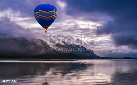 istock Amazing view of beautiful landscape with mountains, clouds and reflection in the water. Artistic picture. Beauty world 894741024