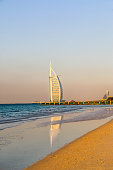 Dubai, United Arab Emirates - 02/05/2018 - Amazing view of Burj Al Arab, Seven Star Hotel, A view from Jumeirah Beach, Arabian Sea, Residential and Business Skyscrapers, Dubai, UAE
