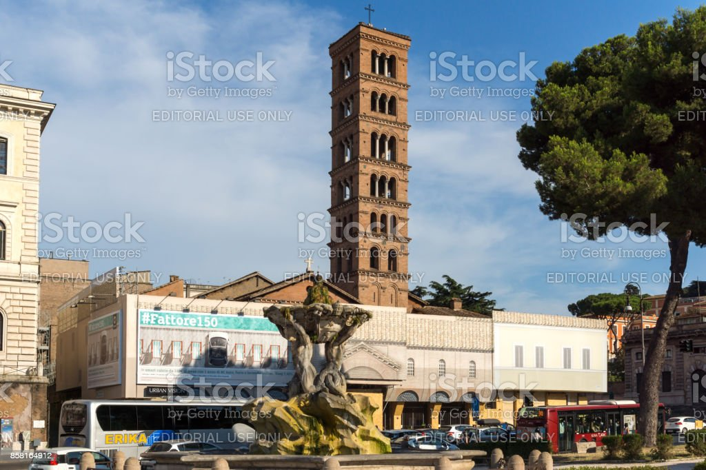 Amazing view of Church of Santa Maria in Cosmedin and Fountain of the Tritons in city of Rome, Italy stock photo
