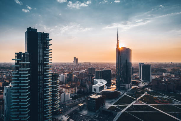 Amazing view of cityscape at sunset in a summer day Skyscraper at sunset in Milan skyscraper stock pictures, royalty-free photos & images