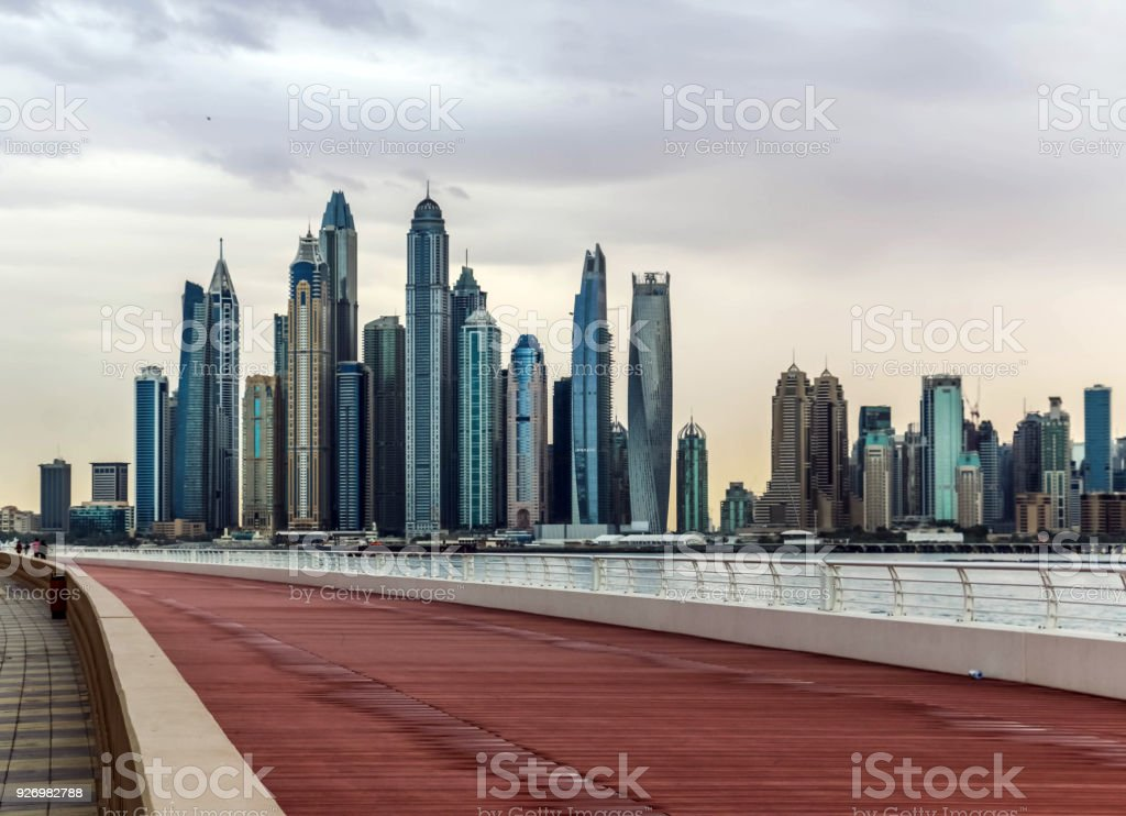 Amazing view of Dubai Marina Skyscrapers, Residential and Business Skyscrapers under cloudy sky in, Dubai, United Arab Emirates stock photo