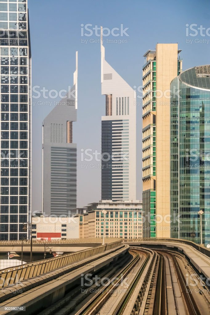 Amazing view of Emirates Towers, Dubai skyscrapers . A view of Twins Towers from Dubai Metro, Sheikh Zayed Road, Residential and Business Skyscrapers in Downtown, Dubai, UAE stock photo