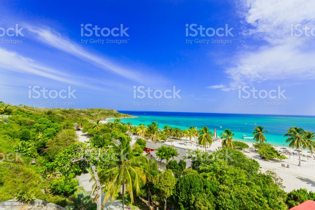 amazing view of Holguing province tropical inviting beach and tranquil azure turquoise ocean on blue sky background stock photo
