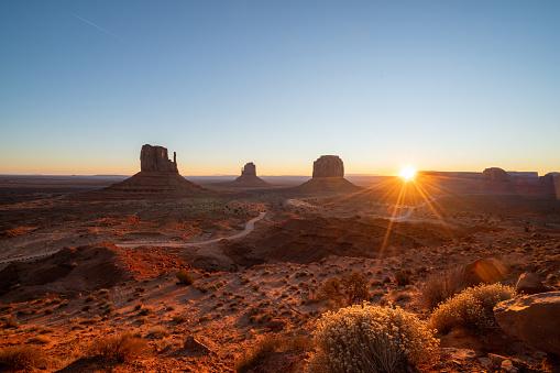 Amazing view of Monument valley at sunrise, Utah, USA; Navajo reservation land Light on horizon