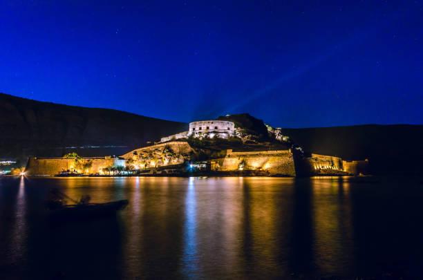 Amazing view of the island of Spinalonga illuminated at night. stock photo