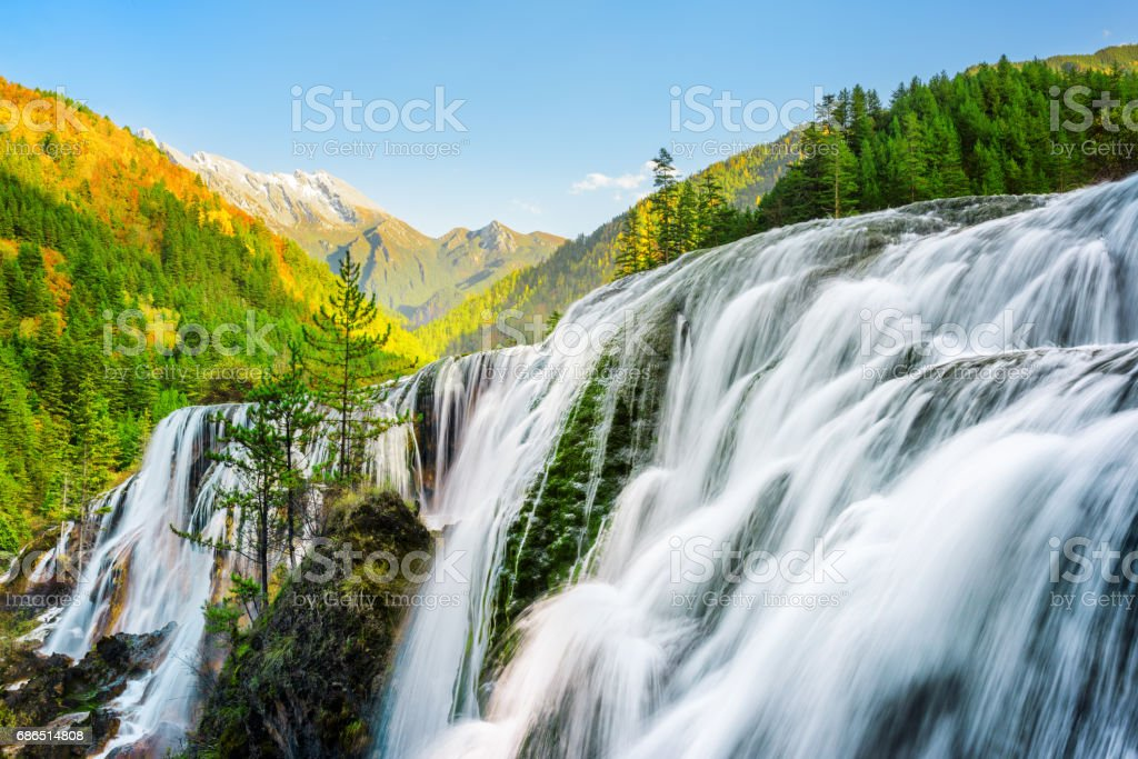 Amazing view of the Pearl Shoals Waterfall among woods at sunset royalty-free stock photo
