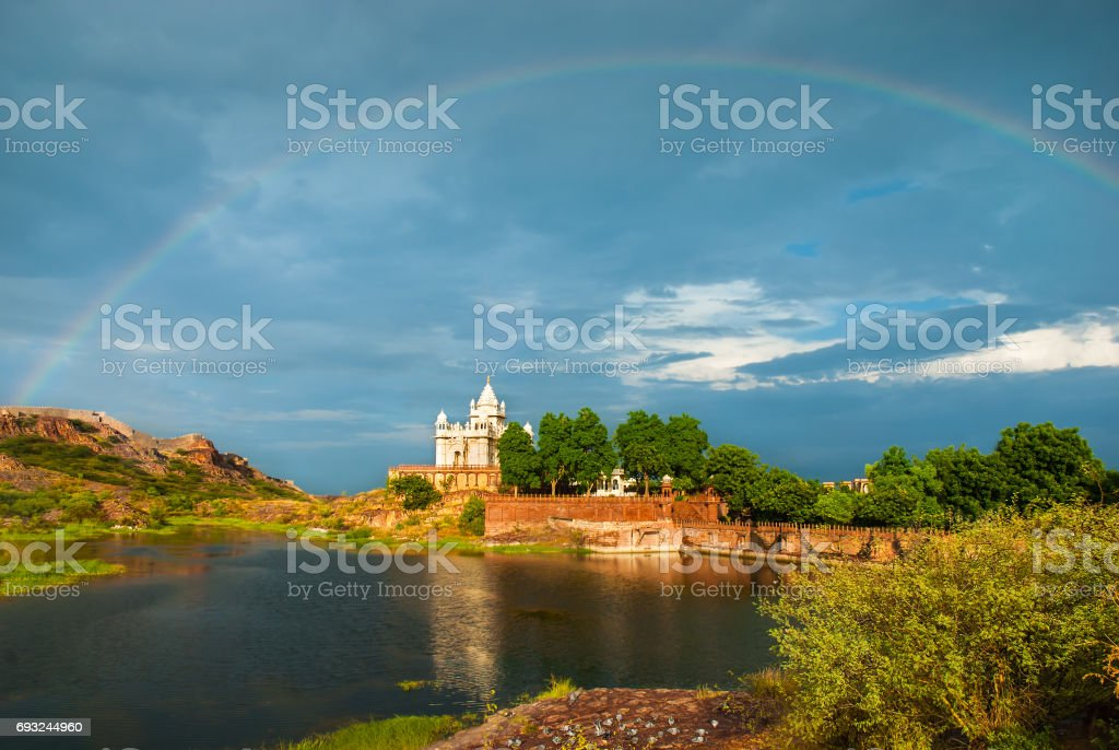 Amazing view on Jaswanth Thada mausoleum after the rain with a rainbow in the sky. Location: Jodhpur, Rajasthan, India. Artistic picture. Beauty world. stock photo