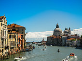 Amazing view on the beautiful Venice, Italy. Many gondolas sailing down one of the canals