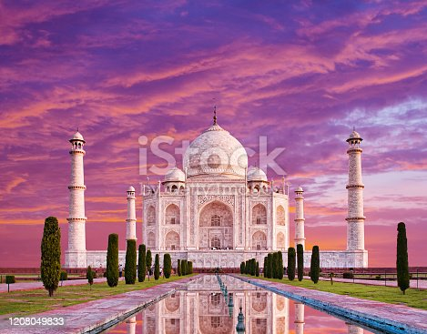 istock Amazing view on the Taj Mahal in sunset light with reflection in water. The Taj Mahal is an white marble mausoleum on the south bank of the Yamuna river. Agra, Uttar Pradesh, India 1208049833