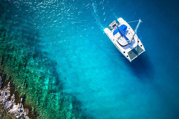 amazing view to catamaran in open sea at windy day - katamaran bildbanksfoton och bilder