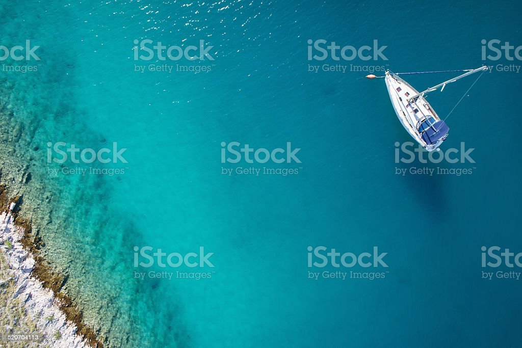 amazing view to yacht and clear water - caribbean paradise stock photo