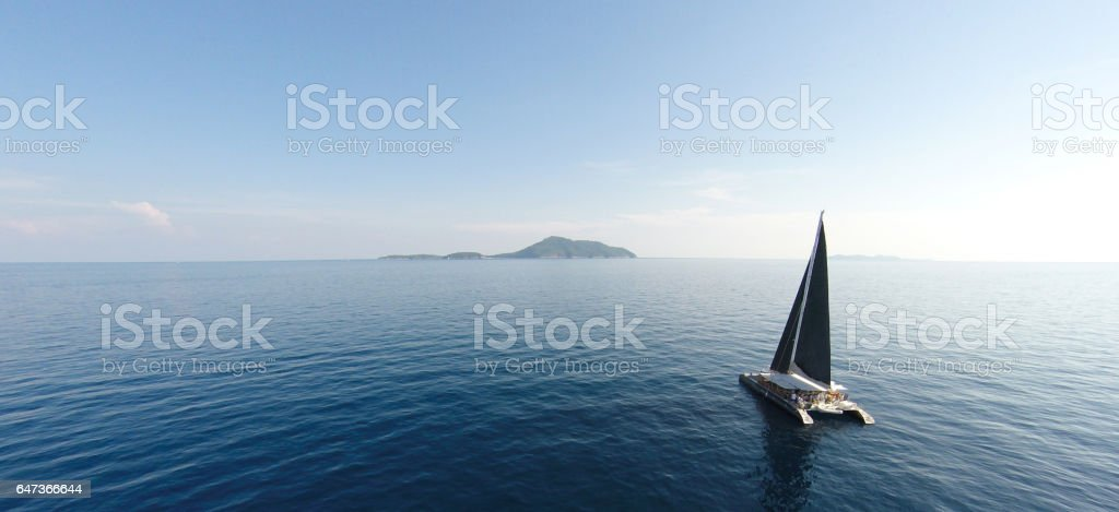 Amazing view to Yacht sailing in open sea at windy day. Drone view - birds eye angle. стоковое фото