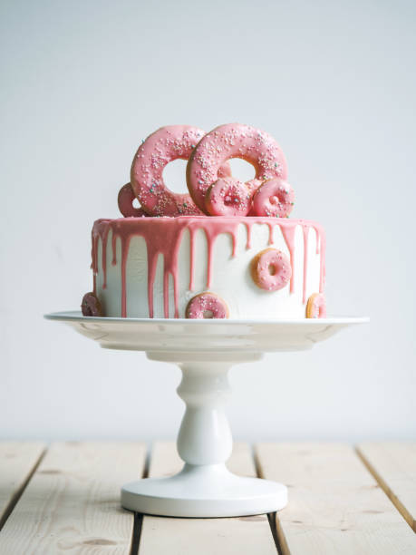 amazing wedding cake with donuts - cake stock photos and pictures