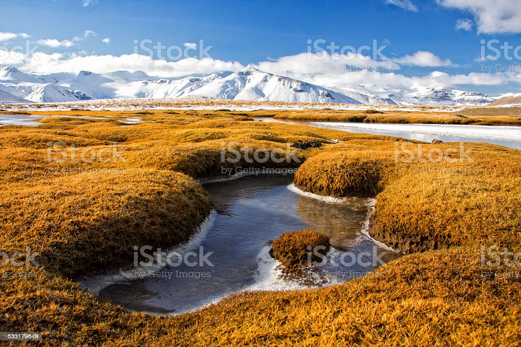 Amazing winter landscape of frozen moors and mountains in Iceland stock photo