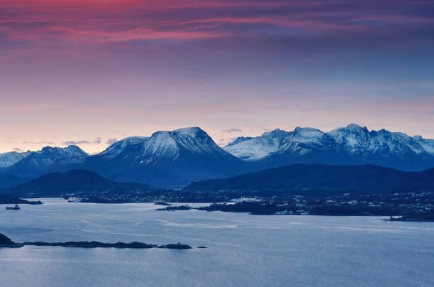 Amazing winter sunrise over Norwegian mountains in Alesund, Norway stock photo