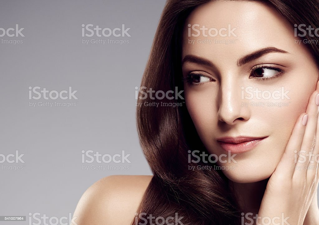 Amazing woman portrait. Beautiful girl with long wavy hair. stock photo