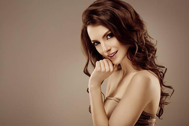 Amazing woman portrait. Beautiful model on beige background stock photo