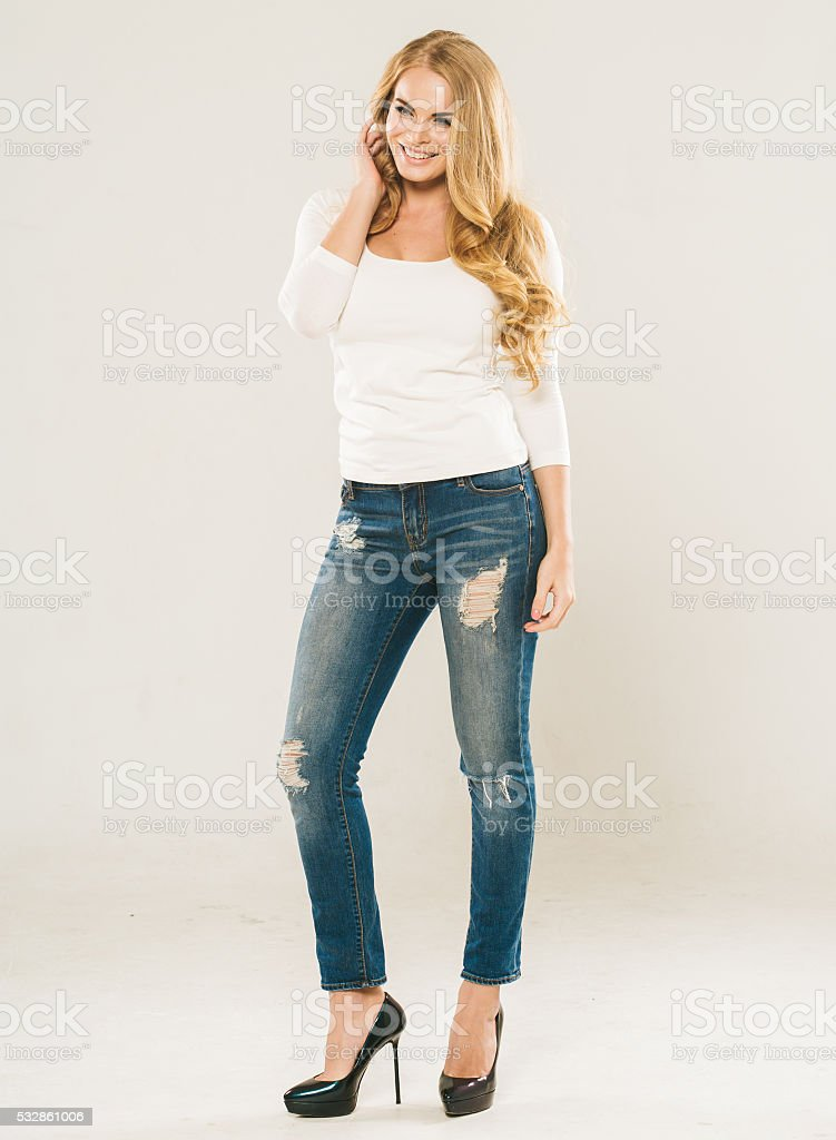 Amazing woman with blonde curly hair portrait jeans stock photo