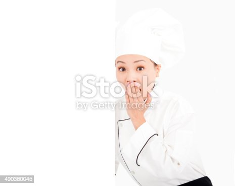 istock amazing young woman chef looking with blank board 490380045