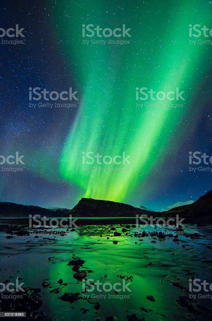 Amazingly reflected celestial lights Aurora Borealis above Iceland's winter sky stock photo