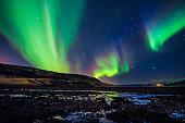 istock Amazingly reflected celestial lights Aurora Borealis above Iceland's winter sky 531332731
