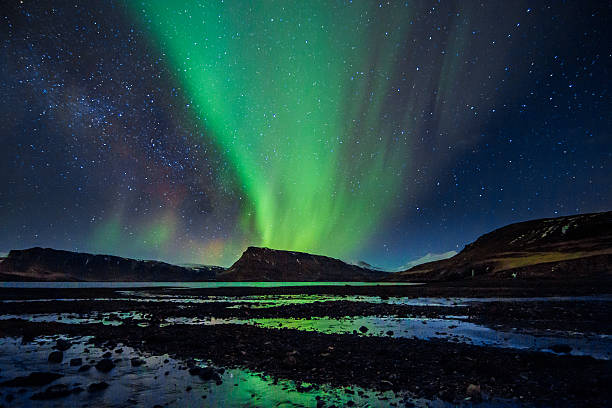 amazingly reflected celestial lights aurora borealis above iceland's winter sky - nightsky bildbanksfoton och bilder