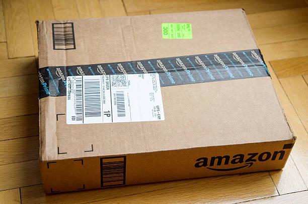 Amazon Box on wooden floor stock photo