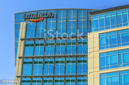 Sunnyvale, California, USA - August 13, 2018: Amazon Logo one of the buildings of Big Amazon campus in Sunnyvale, Silicon Valley. Amazon is leader in electronic commerce and cloud computing.