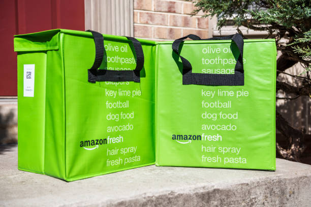 amazon fresh insulated grocery delivery bags on front porch closeup - food logo stock photos and pictures