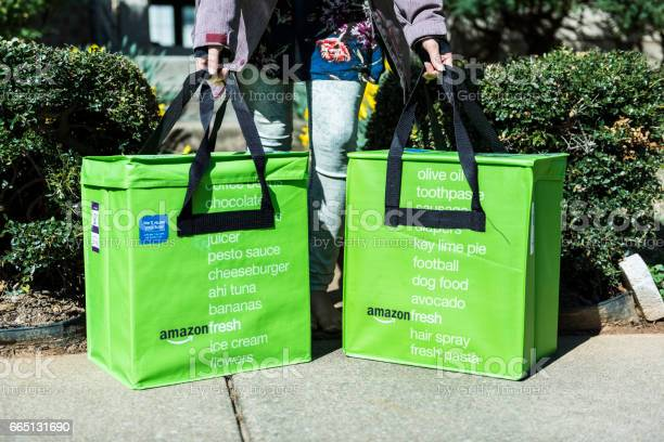 Amazon fresh insulated grocery delivery bags on front porch closeup picture id665131690?b=1&k=6&m=665131690&s=612x612&h= dwtkv9ktkws1abl cdycvnkgtnjeox4mzzrw0eesno=