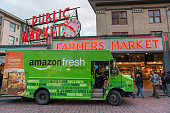 Seattle, USA - February 2, 2016: An Amazon Fresh truck in front of the famous Pike Place Market late in the day.