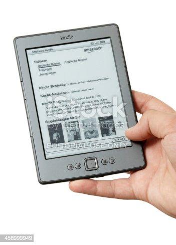 istock Amazon Kindle digital book reader on white background 458999949