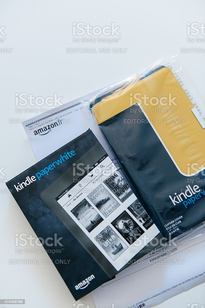 Amazon Kindle Paperwhite and yellow Kindle leather cover stock photo